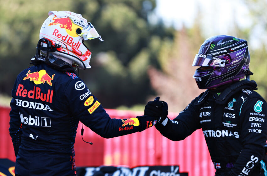 BARCELONA, SPAIN - MAY 08: Pole position qualifier Lewis Hamilton of Great Britain and Mercedes GP shakes hands with second place qualifier Max Verstappen of Netherlands and Red Bull Racing in parc ferme during qualifying for the F1 Grand Prix of Spain at Circuit de Barcelona-Catalunya on May 08, 2021 in Barcelona, Spain. (Photo by Mark Thompson/Getty Images)