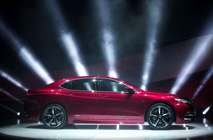 DETROIT, MI - JANUARY 14: The new Acura TLX Prototype vehicle is revealed at the press preview of the 2014 North American International Auto Show January 14, 2014 in Detroit, Michigan. Approximately 5000 journalists from more than 60 countries are expected to attend. The 2014 NAIAS opens to the public on January 18 and ends January 16. (Photo by Bill Pugliano/Getty Images)