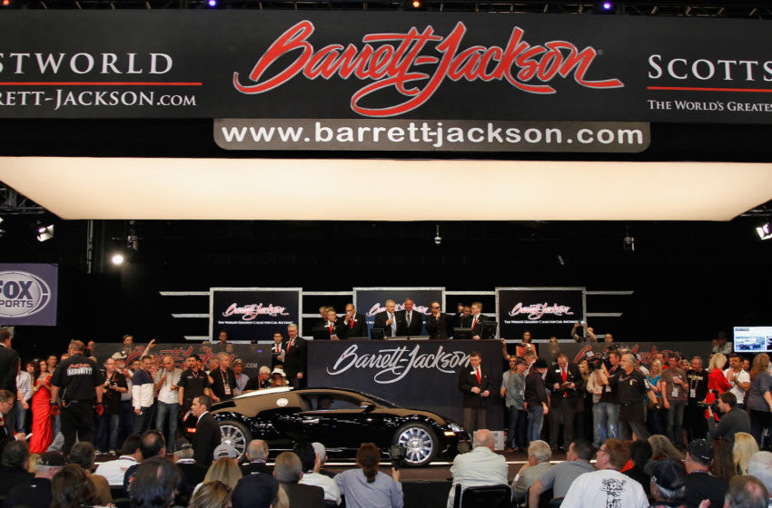 SCOTTSDALE, AZ - JANUARY 18: Simon Cowell's 2008 Bugatti Veyron enters the auction area during the 43rd Annual Barrett-Jackson Scottsdale Auction at WestWorld of Scottsdale on January 18, 2014 in Scottsdale, Arizona. (Photo by Mike Moore/Getty Images)