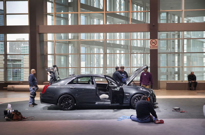 CHICAGO, IL - FEBRUARY 08: Workers prepare a Cadillac CTS-V for the opening of the Chicago Auto Show on February 8, 2017 in Chicago, Illinois. The auto show, which is the nation's largest, is open to the public February 11-20. (Photo by Scott Olson/Getty Images)