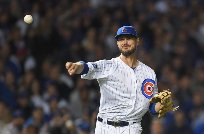 CHICAGO, IL - OCTOBER 02: Kris Bryant #17 of the Chicago Cubs throws to first base in the eleventh inning against the Colorado Rockies during the National League Wild Card Game at Wrigley Field on October 2, 2018 in Chicago, Illinois. (Photo by Stacy Revere/Getty Images)