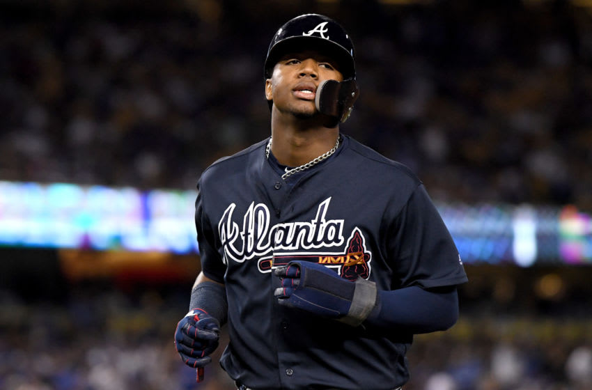 LOS ANGELES, CA - OCTOBER 04: Ronald Acuna Jr. #13 of the Atlanta Braves reacts after being caught stealing during the sixth inning against the Los Angeles Dodgers during Game One of the National League Division Series at Dodger Stadium on October 4, 2018 in Los Angeles, California. (Photo by Harry How/Getty Images)
