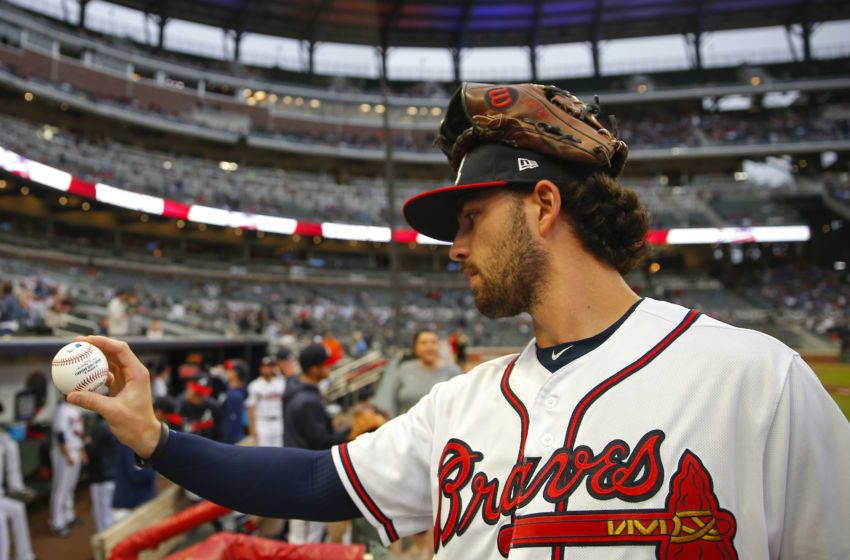 ATLANTA, GA - APRIL 4: Dansby Swanson #7 of the Atlanta Braves throws a ball to the fans prior to the first inning of an MLB game against the Chicago Cubs at SunTrust Park on April 4, 2018 in Atlanta, Georgia. (Photo by Todd Kirkland/Getty Images)