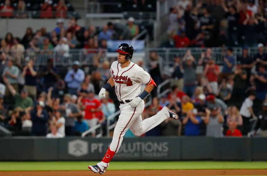 ATLANTA, GEORGIA - MAY 15: Austin Riley #27 of the Atlanta Braves rounds first base after his first Major League home run in the fourth inning during his MLB debut against the St. Louis Cardinals at SunTrust Park on May 15, 2019 in Atlanta, Georgia. (Photo by Kevin C. Cox/Getty Images)