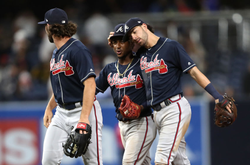 SAN DIEGO, CALIFORNIA - JULY 12: Austin Riley #27, Ozzie Albies #1 and Dansby Swanson #7 of the Atlanta Braves celebrate after defeating the San Diego Padres 5-3 in a game at PETCO Park on July 12, 2019 in San Diego, California. (Photo by Sean M. Haffey/Getty Images)