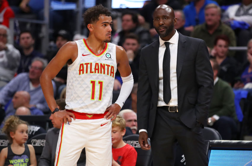 DETROIT, MICHIGAN - OCTOBER 24: Trae Young #11 of the Atlanta Hawks talks with head coach Lloyd Pierce while playing the Detroit Pistons at Little Caesars Arena on October 24, 2019 in Detroit, Michigan. NOTE TO USER: User expressly acknowledges and agrees that, by downloading and/or using this photograph, user is consenting to the terms and conditions of the Getty Images License Agreement. (Photo by Gregory Shamus/Getty Images) (Photo by Gregory Shamus/Getty Images)