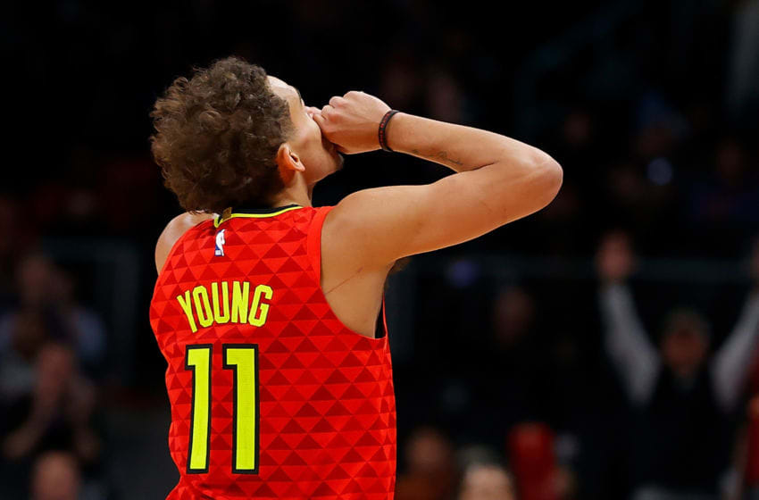 ATLANTA, GEORGIA - JANUARY 26: Trae Young #11 of the Atlanta Hawks reacts after hitting a three-point basket against the Washington Wizards in the second half at State Farm Arena on January 26, 2020 in Atlanta, Georgia. NOTE TO USER: User expressly acknowledges and agrees that, by downloading and/or using this photograph, user is consenting to the terms and conditions of the Getty Images License Agreement. (Photo by Kevin C. Cox/Getty Images)