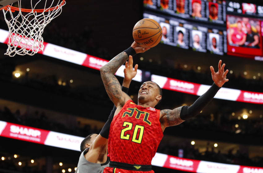 ATLANTA, GA - FEBRUARY 28: John Collins #20 of the Atlanta Hawks goes up for a shot during the first half of an NBA game against the Brooklyn Nets at State Farm Arena on February 28, 2020 in Atlanta, Georgia. NOTE TO USER: User expressly acknowledges and agrees that, by downloading and/or using this photograph, user is consenting to the terms and conditions of the Getty Images License Agreement. (Photo by Todd Kirkland/Getty Images)