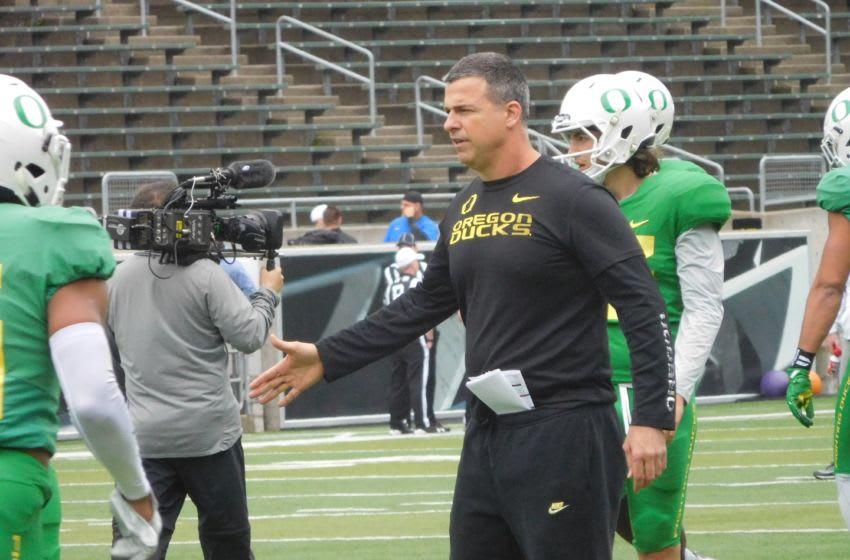 Oregon Football practices inside Autzen Stadium as Head Coach Mario Cristobal looks on. Justin Phillips/KPNW Sports