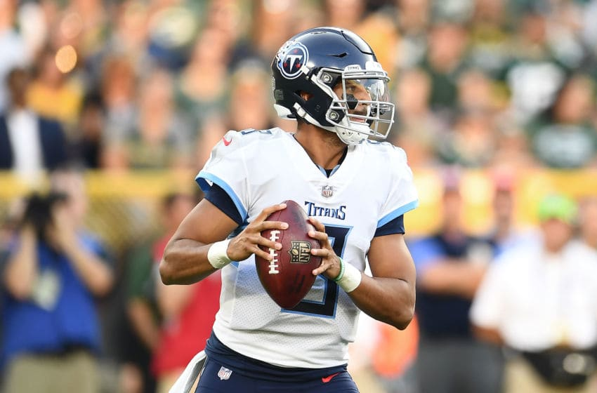GREEN BAY, WI - AUGUST 09: Marcus Mariota #8 of the Tennessee Titans drops back to pass during a preseason game against the Green Bay Packers at Lambeau Field on August 9, 2018 in Green Bay, Wisconsin. (Photo by Stacy Revere/Getty Images)