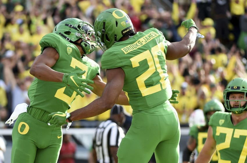 EUGENE, OR - SEPTEMBER 22: Running back Tony Brooks-James #20 celebrates with wide receiver Johnny Johnson III #3 of the Oregon Ducks after scoring a touchdown during the first quarter of the game against the Stanford Cardinal at Autzen Stadium on September 22, 2018 in Eugene, Oregon. (Photo by Steve Dykes/Getty Images)