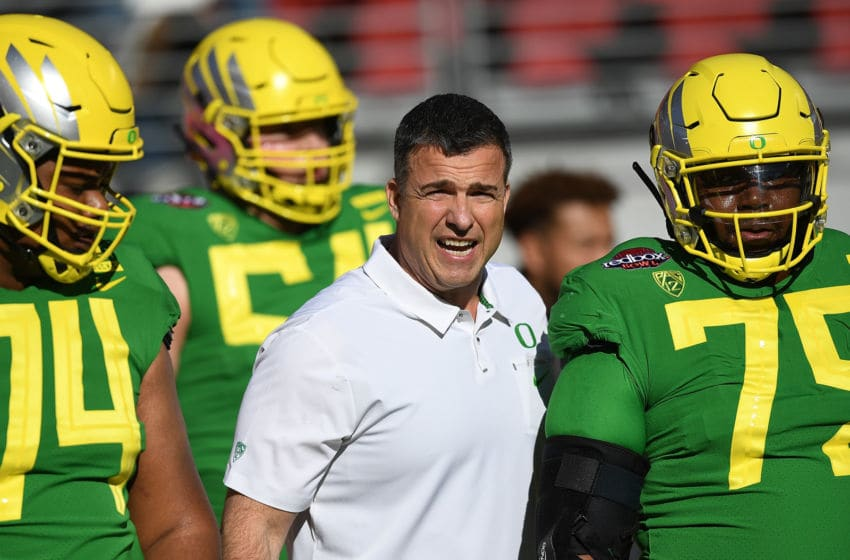 SANTA CLARA, CA - DECEMBER 31: Head coach Mario Cristobal of the Oregon Ducks works with his players during pre-game warm ups prior to the start of the Redbox Bowl against the Michigan State Spartans at Levi's Stadium on December 31, 2018 in Santa Clara, California. (Photo by Thearon W. Henderson/Getty Images)