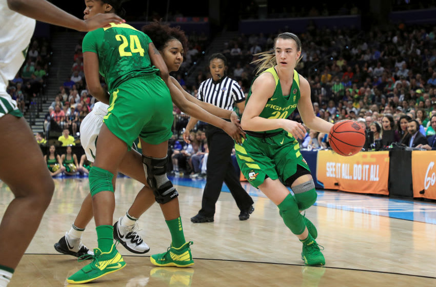 TAMPA, FLORIDA - APRIL 05: Sabrina Ionescu #20 of the Oregon Ducks drives to the basket against the Baylor Lady Bears during the first half in the semifinals of the 2019 NCAA Women's Final Four at Amalie Arena on April 05, 2019 in Tampa, Florida. (Photo by Mike Ehrmann/Getty Images)