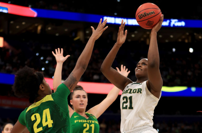 TAMPA, FLORIDA - APRIL 05: Kalani Brown #21 of the Baylor Lady Bears attempts a shot against Ruthy Hebard #24 and Erin Boley #21 of the Oregon Ducks during the fourth quarter in the semifinals of the 2019 NCAA Women's Final Four at Amalie Arena on April 05, 2019 in Tampa, Florida. (Photo by Mike Ehrmann/Getty Images)