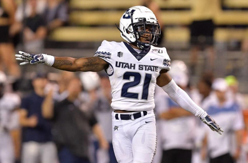 WINSTON SALEM, NORTH CAROLINA - AUGUST 30: Andre Grayson #21 of the Utah State Aggies against the Wake Forest Demon Deacons during their game at BB&T Field on August 30, 2019 in Winston Salem, North Carolina. Wake Forest won 38-35. (Photo by Grant Halverson/Getty Images)