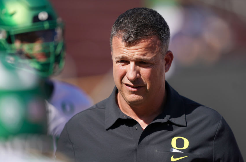 PALO ALTO, CA - SEPTEMBER 21: Head coach Mario Cristobal of the Oregon Ducks looks on while his team warms up prior to the start of an NCAA football game against the Stanford Cardinal at Stanford Stadium on September 21, 2019 in Palo Alto, California. (Photo by Thearon W. Henderson/Getty Images)