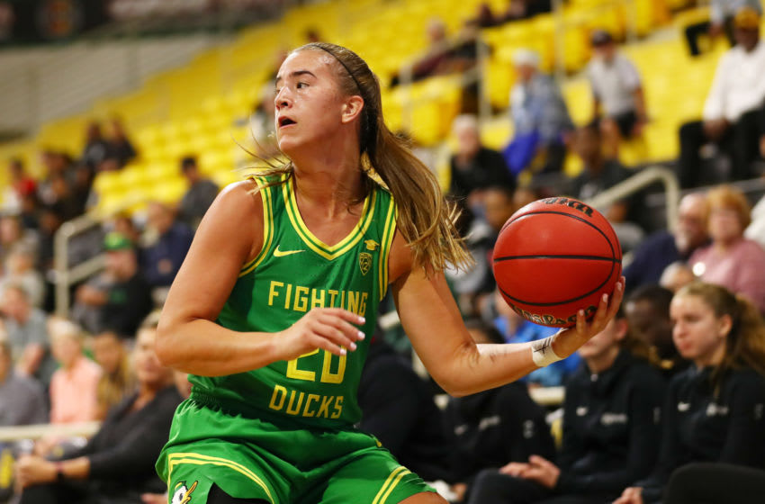 LONG BEACH, CALIFORNIA - DECEMBER 14: Sabrina Ionescu #20 of the Oregon Ducks moves the ball in the second quarter against Long Beach State at Walter Pyramid on December 14, 2019 in Long Beach, California. (Photo by Joe Scarnici/Getty Images)