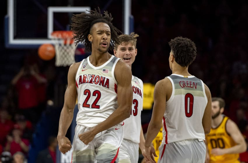 TUCSON, ARIZONA - JANUARY 04: Zeke Nnaji #22 of the Arizona Wildcats celebrates on the court with Josh Green #0 in the second half State Sun Devils at McKale Center on January 04, 2020 in Tucson, Arizona. The Arizona Wildcats won (Photo by Jennifer Stewart/Getty Images)
