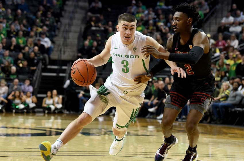 EUGENE, OREGON - JANUARY 23: Payton Pritchard #3 of the Oregon Ducks drives to the basket on Jonah Mathews #2 of the USC Trojans during the first half at Matthew Knight Arena on January 23, 2020 in Eugene, Oregon. (Photo by Steve Dykes/Getty Images)