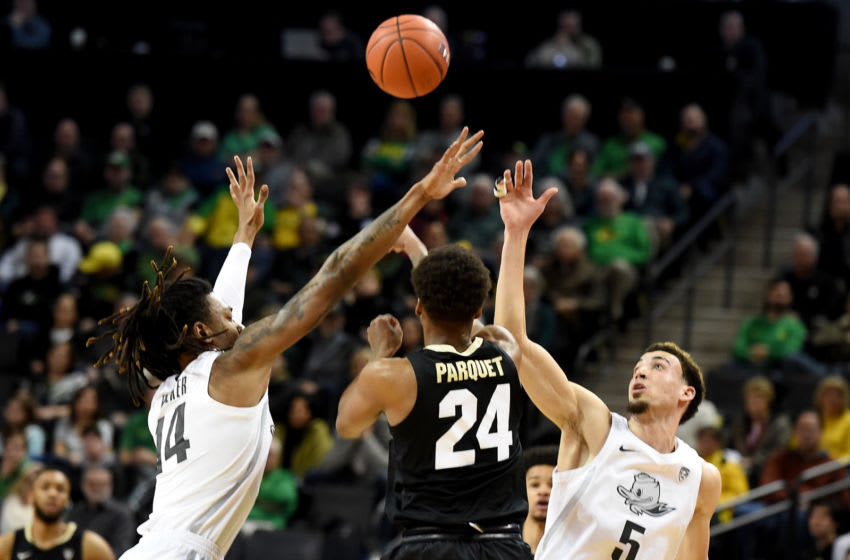 EUGENE, OREGON - FEBRUARY 13: C.J. Walker #14 and Chris Duarte #5 of the Oregon Ducks try and trap Eli Parquet #24 of the Colorado Buffaloes during the first half at Matthew Knight Arena on February 13, 2020 in Eugene, Oregon. (Photo by Steve Dykes/Getty Images)