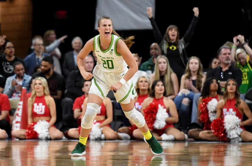 LAS VEGAS, NEVADA - MARCH 06: Sabrina Ionescu #20 of the Oregon Ducks reacts after a teammate hit a 3-pointer against the Utah Utes during the Pac-12 Conference women's basketball tournament quarterfinals at the Mandalay Bay Events Center on March 6, 2020 in Las Vegas, Nevada. The Ducks defeated the Utes 79-59. (Photo by Ethan Miller/Getty Images)