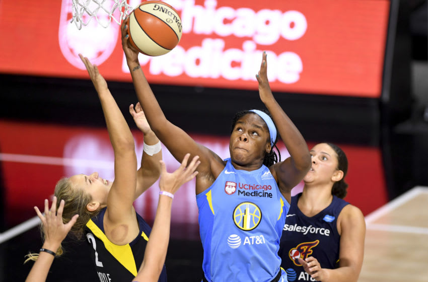 PALMETTO, FLORIDA - AUGUST 22: Ruthy Hebard #24 of the Chicago Sky makes a rebound in front of Kathleen Doyle #2 of the Indiana Fever during the second half at Feld Entertainment Center on August 22, 2020 in Palmetto, Florida. NOTE TO USER: User expressly acknowledges and agrees that, by downloading and or using this photograph, User is consenting to the terms and conditions of the Getty Images License Agreement. (Photo by Douglas P. DeFelice/Getty Images)