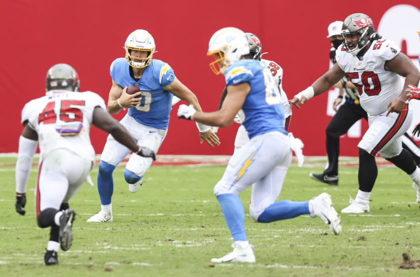 TAMPA, FLORIDA - OCTOBER 04: Justin Herbert #10 of the Los Angeles Chargers runs for yardage during the fourth quarter of a game against the Tampa Bay Buccaneers at Raymond James Stadium on October 04, 2020 in Tampa, Florida. (Photo by James Gilbert/Getty Images)