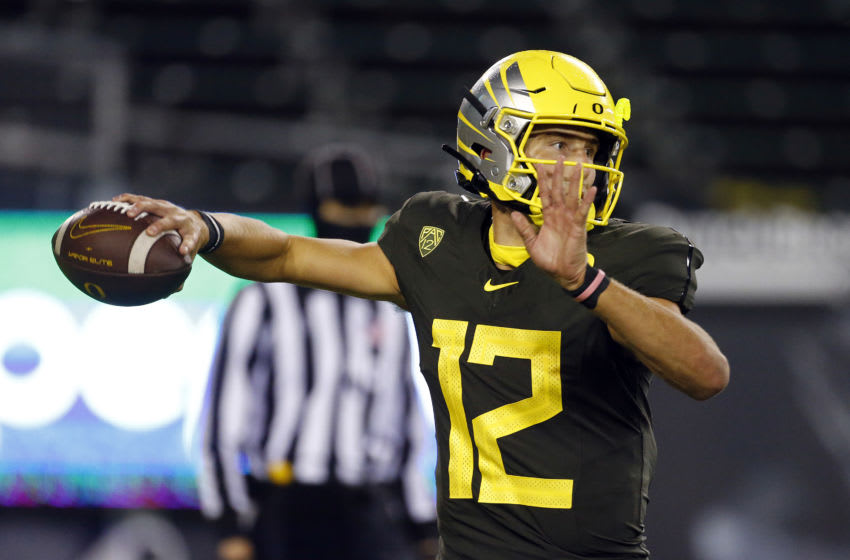 EUGENE, OREGON - NOVEMBER 07: Tyler Shough #12 of the Oregon Ducks throws against the Stanford Cardinal at Autzen Stadium on November 07, 2020 in Eugene, Oregon. (Photo by Jonathan Ferrey/Getty Images)