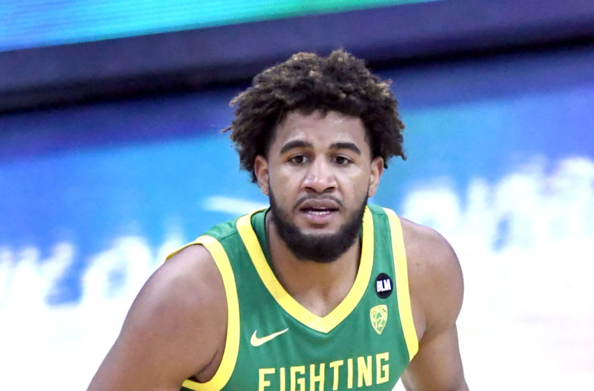 OMAHA, NE - DECEMBER 04: LJ Figueroa #30 of the Oregon Ducks looks on during a college basketball game against the Seton Hall Pirates on December 4, 2020 at the CHI Health Center in Omaha, Nebraska. (Photo by Mitchell Layton/Getty Images)