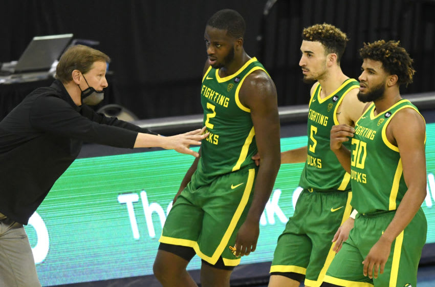 OMAHA, NE - DECEMBER 04: Head Dana Altman talks to Eugene Omoruyi #2, Chris Duarte #5, and LJ Figueroa #30 during a college basketball game against the Seton Hall Pirates on December 4, 2020 at the CHI Health Center in Omaha, Nebraska. (Photo by Mitchell Layton/Getty Images)