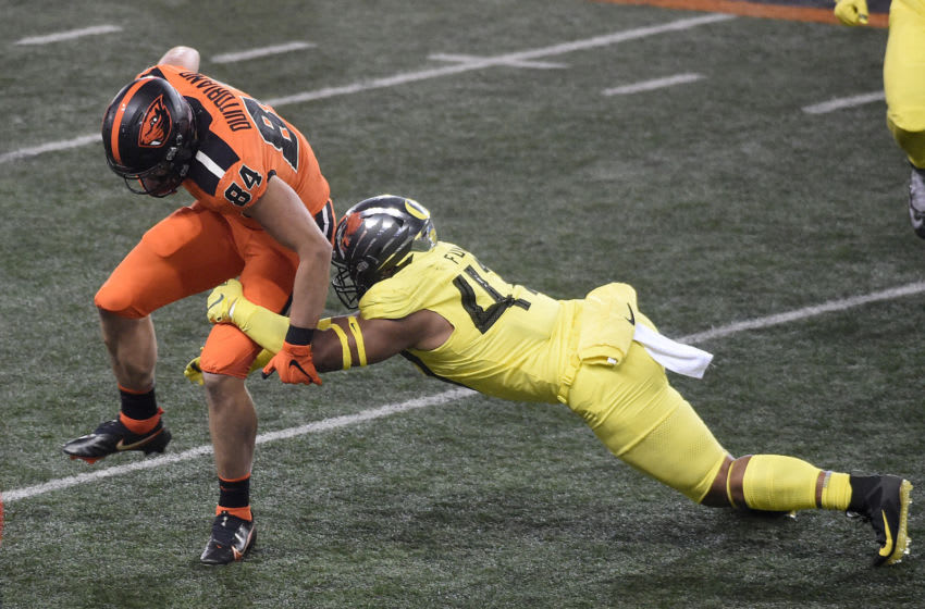 CORVALLIS, OREGON - NOVEMBER 27: Tight end Teagan Quitoriano #84 of the Oregon State Beavers avoids the tackle of linebacker Mase Funa #47 of the Oregon Ducks during the second half of the game at Reser Stadium on November 27, 2020 in Corvallis, Oregon. Oregon State won 41-38. (Photo by Steve Dykes/Getty Images)