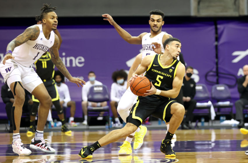 SEATTLE, WASHINGTON - DECEMBER 12: Chris Duarte #5 of the Oregon Ducks handles the ball against Jamal Bey #5 of the Washington Huskies in the first half at Alaska Airlines Arena on December 12, 2020 in Seattle, Washington. (Photo by Abbie Parr/Getty Images)
