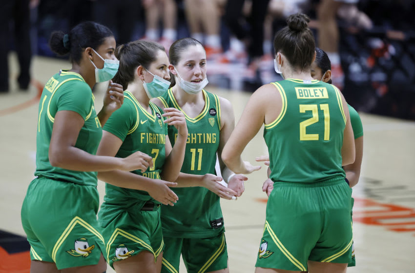 CORVALLIS, OREGON - DECEMBER 13: The Oregon Ducks starting five (L-R) Nyara Sabally #1, Taylor Chavez #3, Taylor Mikesell #11 , Erin Boley #21 and Te-Hina Paopao #12 of the Oregon Ducks huddle prior to a game against the Oregon State Beavers at Gill Coliseum on December 13, 2020 in Corvallis, Oregon. (Photo by Soobum Im/Getty Images)