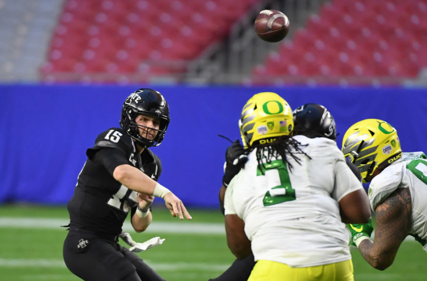 GLENDALE, ARIZONA - JANUARY 02: Brock Purdy #15 of the Iowa State Cyclones throws the ball against the Oregon Ducks during the fourth quarter of the Playstation Fiesta Bowl at State Farm Stadium on January 02, 2021 in Glendale, Arizona. Iowa State won 34-17. (Photo by Norm Hall/Getty Images)