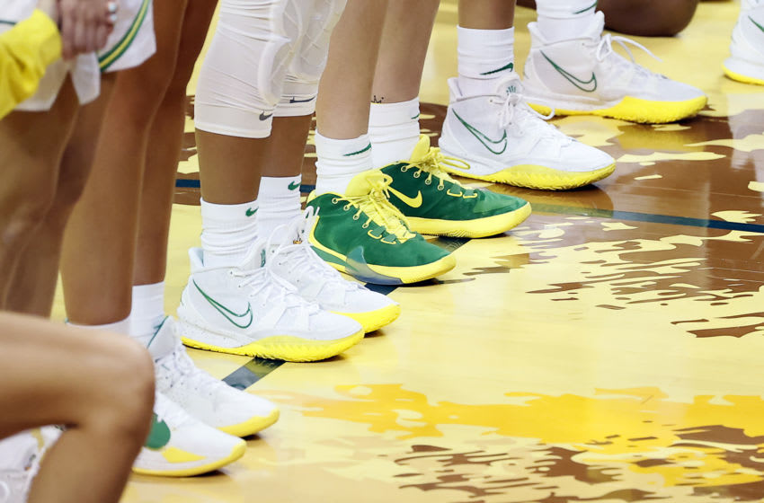 EUGENE, OREGON - JANUARY 03: Oregon Ducks player's shoes are shown as they stand during the singing of the National Anthem before the game against the UCLA Bruins at Matthew Knight Arena on January 03, 2021 in Eugene, Oregon. (Photo by Soobum Im/Getty Images)
