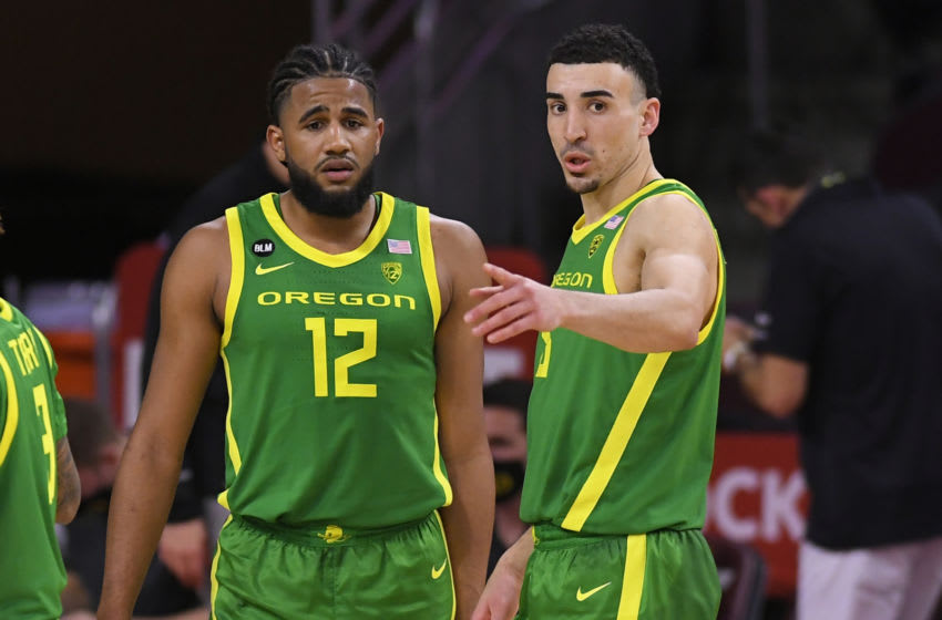 LOS ANGELES, CA - FEBRUARY 22: LJ Figueroa #12 and Chris Duarte #5 of the Oregon Ducks while playing the USC Trojans at Galen Center on February 22, 2021 in Los Angeles, California. (Photo by John McCoy/Getty Images)