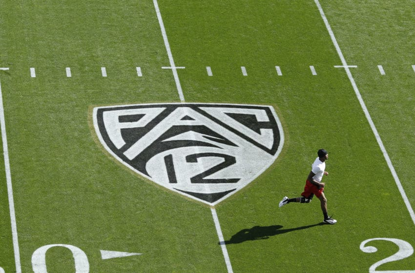 BOULDER, CO - OCTOBER 22: Detail view of the Pac 12 logo on the field as a player warms up before the game between the Colorado Buffaloes and Oregon Ducks at Folsom Field on October 22, 2011 in Boulder, Colorado. The Ducks defeated the Buffaloes 45-2. (Photo by Joe Robbins/Getty Images)