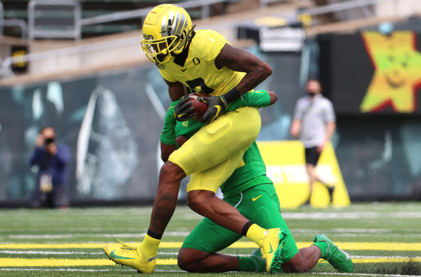 EUGENE, OREGON - MAY 01: Devon Williams #2 of the Oregon Ducks is tackled by Jaylin Davies #6 of the Oregon Ducks in the first quarter during the Oregon spring game at Autzen Stadium on May 01, 2021 in Eugene, Oregon. (Photo by Abbie Parr/Getty Images)