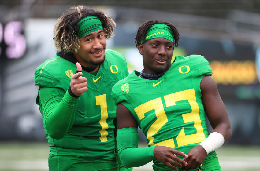 EUGENE, OREGON - MAY 01: Noah Sewell #1 and Verone McKinley III #23 of the Oregon Ducks pose for a photo during the Oregon spring game at Autzen Stadium on May 01, 2021 in Eugene, Oregon. (Photo by Abbie Parr/Getty Images)
