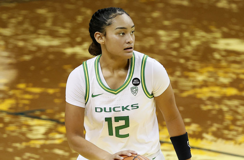 EUGENE, OREGON - JANUARY 03: Te-Hina Paopao #12 of the Oregon Ducks dribbles the ball during the third quarter against the UCLA Bruins at Matthew Knight Arena on January 03, 2021 in Eugene, Oregon. (Photo by Soobum Im/Getty Images)
