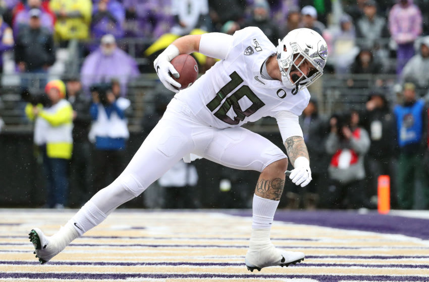 SEATTLE, WASHINGTON - OCTOBER 19: Spencer Webb #18 of the Oregon Ducks scores a 12 yard touchdown catch against the Washington Huskies in the first quarter during their game at Husky Stadium on October 19, 2019 in Seattle, Washington. (Photo by Abbie Parr/Getty Images)