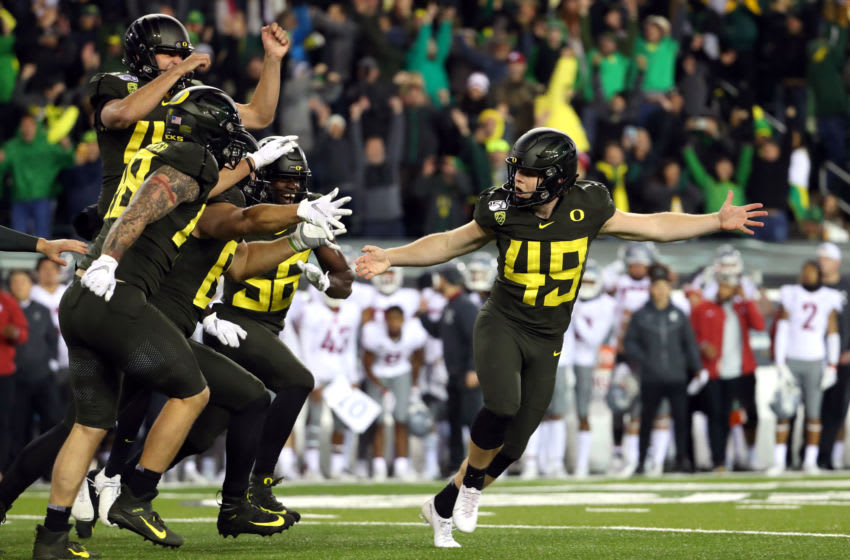 EUGENE, OREGON - OCTOBER 26: Camden Lewis #49 of the Oregon Ducks celebrates with teammates after kicking the game winning field goal to defeat the 37-35 during their game at Autzen Stadium on October 26, 2019 in Eugene, Oregon. (Photo by Abbie Parr/Getty Images)