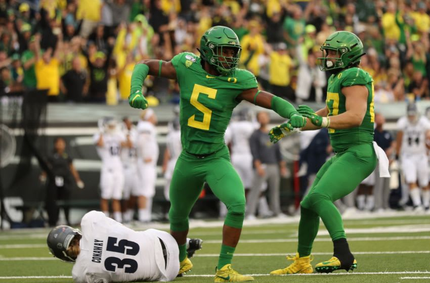 (EDITORS NOTE: caption correction) Sep 7, 2019; Eugene, OR, USA; Oregon Ducks defensive end Kayvon Thibodeaux (5) reacts after making a tackle on Nevada Wolf Pack punter Quinton Conaway (35) in the first half at Autzen Stadium. Mandatory Credit: Jaime Valdez-USA TODAY Sports