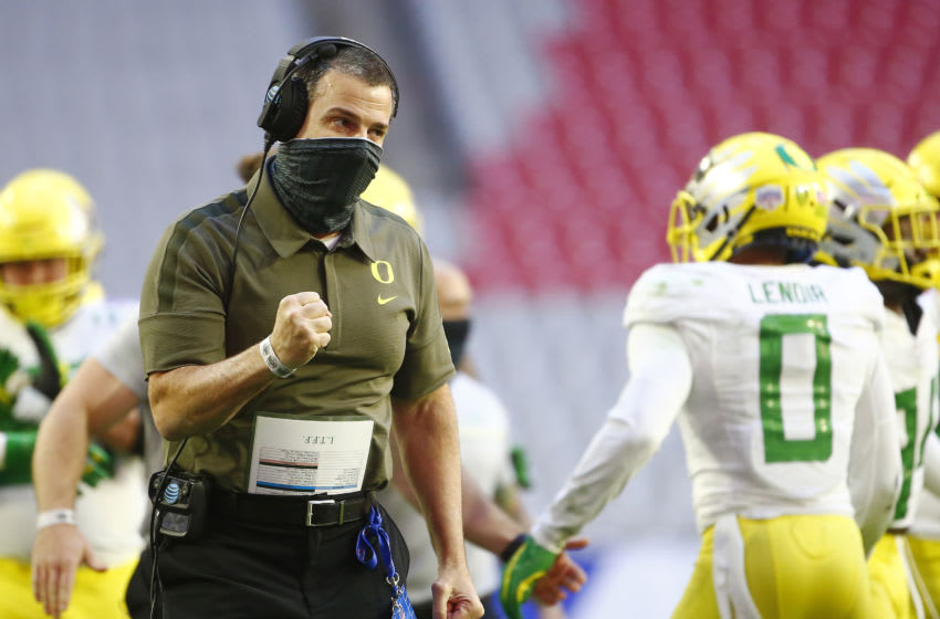 Jan 2, 2021; Glendale, AZ, USA; Oregon Ducks head coach Mario Cristobal reacts against the Iowa State Cyclones in the Fiesta Bowl at State Farm Stadium. Mandatory Credit: Patrick Breen-USA TODAY Sports