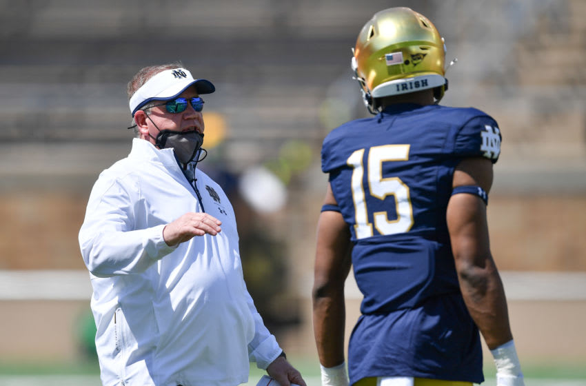 May 1, 2021; Notre Dame, Indiana, USA; Notre Dame Fighting Irish head coach Brian Kelly talks to wide receiver Jordan Johnson (15) in the first half of the Blue-Gold Game at Notre Dame Stadium. Mandatory Credit: Matt Cashore-USA TODAY Sports