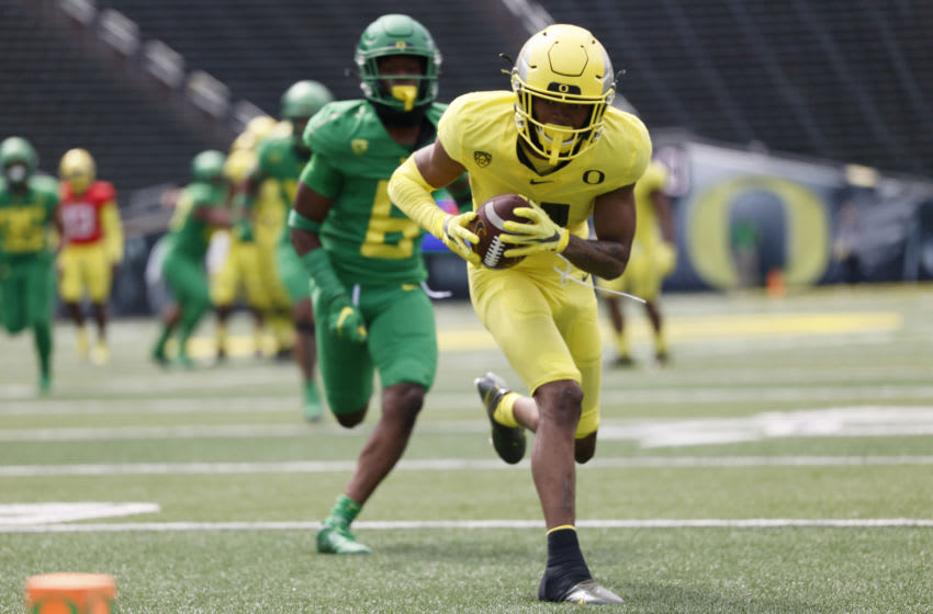 May 1, 2021; Eugene, Oregon, USA; Oregon Ducks wide receiver Troy Franklin (11) makes a catch in front of corner back Jaylin Davies (6) during Oregon Spring Game at Autzen Stadium. Mandatory Credit: Soobum Im-USA TODAY Sports