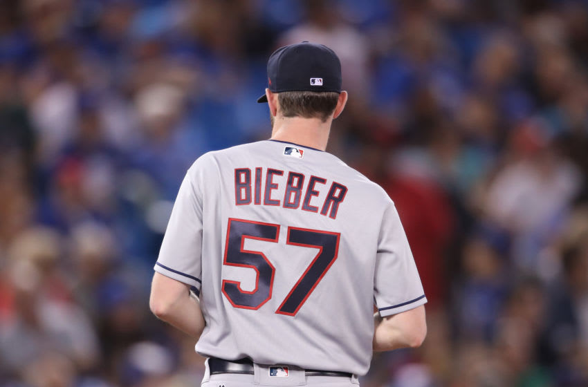 TORONTO, ON - SEPTEMBER 6: A view of the back of the jersey worn by Shane Bieber #57 of the Cleveland Indians as he comes set on the mound before delivering a pitch in the fourth inning during MLB game action against the Toronto Blue Jays at Rogers Centre on September 6, 2018 in Toronto, Canada. (Photo by Tom Szczerbowski/Getty Images)