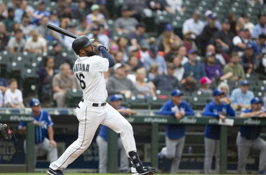 SEATTLE, WA - JUNE 19: Domingo Santana #16 of the Seattle Mariners follows through on a solo home run in the sixth inning against the Kansas City Royals at T-Mobile Park on June 19, 2019 in Seattle, Washington. (Photo by Lindsey Wasson/Getty Images)
