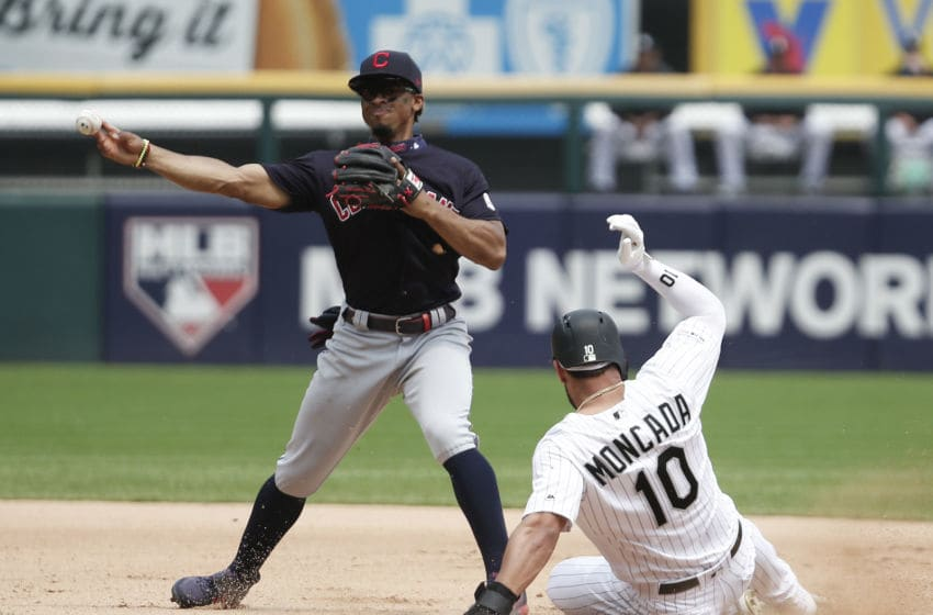 CHICAGO, ILLINOIS - JUNE 01: Yoan Moncada #10 of the Chicago White Sox is safe at second base in front of Francisco Lindor #12 of the Cleveland Indians during the fourth inning at Guaranteed Rate Field on June 01, 2019 in Chicago, Illinois. (Photo by Nuccio DiNuzzo/Getty Images)