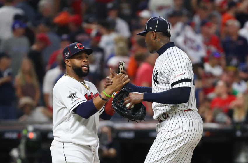 CLEVELAND, OHIO - JULY 09: Carlos Santana #41 of the Cleveland Indians and the American League celebrates with Aroldis Chapman #54 of the New York Yankees and the American League after defeating the National League All-Stars 4-3 in the 2019 MLB All-Star Game, presented by Mastercard at Progressive Field on July 09, 2019 in Cleveland, Ohio. (Photo by Gregory Shamus/Getty Images)